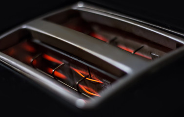 Glowing resistances inside black toaster