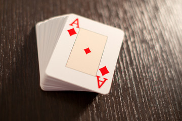 Deck of playing cards showing the ace of diamonds