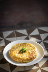 spanish tortilla traditional omelet on rustic tiles
