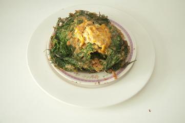 cha-om omelet in white plate