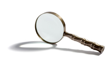 Round metal magnifying glass with a shadow