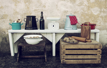 Vintage Kitchen Utensils Still Life with Food and Other Tools in Front of Grunge Wall Texture
