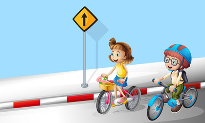 Boy and girl riding bike on the street