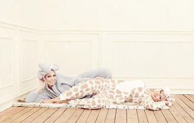Two young women in a pajamas having fun.