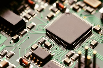 Close-up of electronic circuit board with components. Motherboard in to a PC