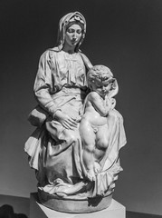 Old statue of a suffering woman with child