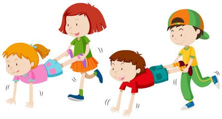 Children playing wheel barrow