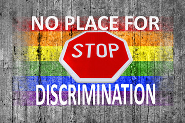 No place for discrimination and STOP sign and LGBT flag painted