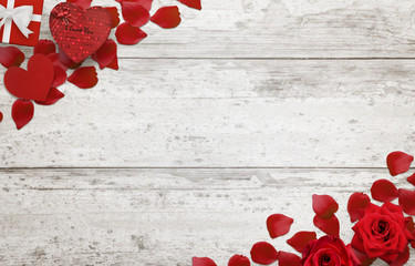Love background scene with free space for text. Petals, rose, gift heart on wooden background.