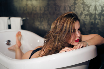 Beautiful female model relaxing in bath tub
