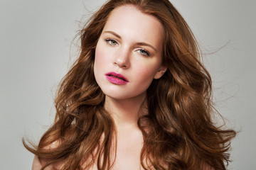 Beauty Woman Portrait. Healthy Long Red Hair and perfect holiday