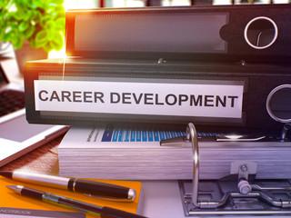 Black Office Folder with Inscription Career Development on Office Desktop with Office Supplies and Modern Laptop. Career Development Business Concept on Blurred Background. 3D Render