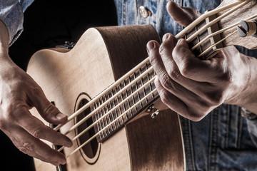 playing ukulele bass