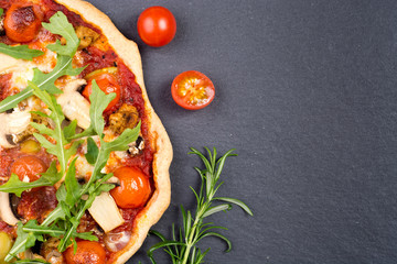 Homemade pizza with rucola