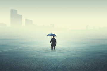business man looking at the city underwater