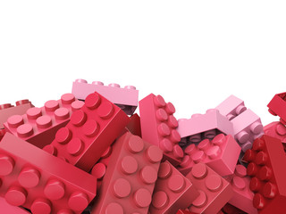 toy plastic bricks background in pink and red
