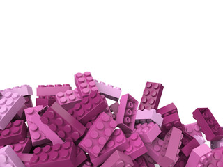 toy plastic bricks background in pink