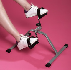 Exercising feet and ankles using an exercise machine
