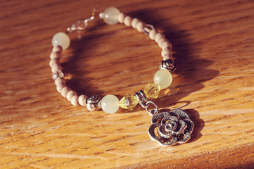 Bracelet with rose pendant and jadeite mineral gem stone