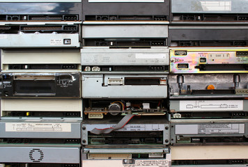 Rear panels of old floppy cd and dvd drives as background
