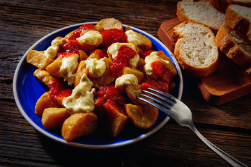 Tapas Patatas Bravas potatoe fries with tomato