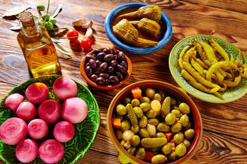 Tapas pickles mix olives chili onion eggplant