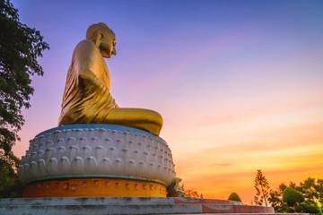 Buddha statue in sunrise at Wat Tang Sai Temple, Prachuapkhirikhan, Thailand.