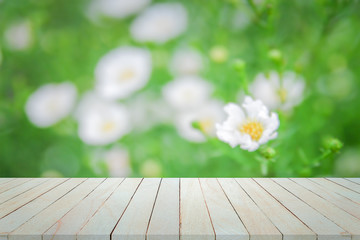 Empty top view of wooden table  on flower bokeh background, For