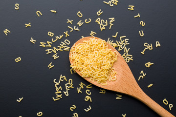 alphabet pasta in spoon