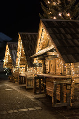 Christmas market on Old Town Square consist of decorated wooden huts