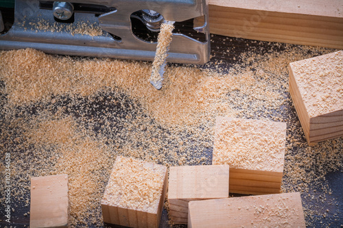 Quot electrical fretsaw sawdust and wooden bricks on vintage