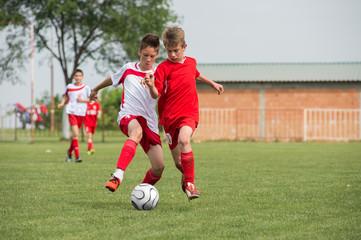boys kicking football