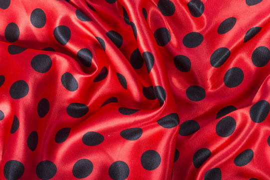 black and red polka dot satin fabric background