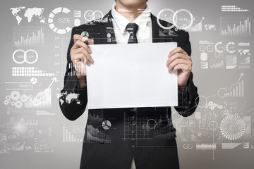 businessman holding paper with graph