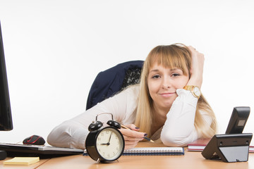 Tired office employee tries to schedule the working day