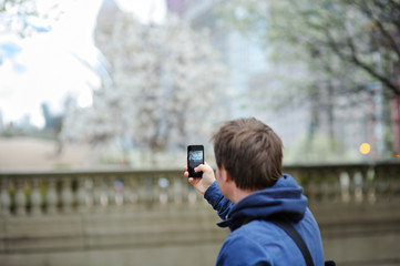 Male tourist taking mobile photo using his phone