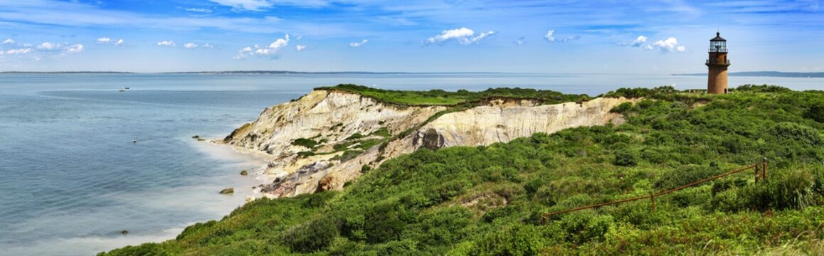 Panorama of a Gay Head lighthouse on a cliff in Aquinnah, Marthas Vineyard