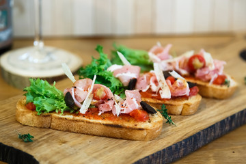 toasted bread slice with smoked ham and cheese