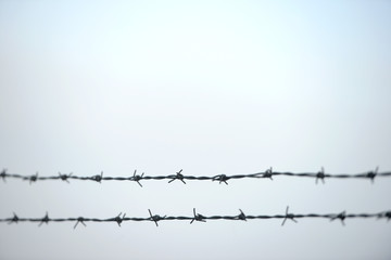 Double horizontal barb wire fence