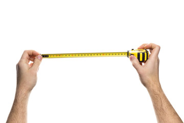 Hands holding measuring tape