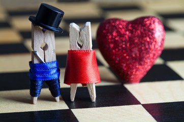 Love concept. Clothespins: romantic couple. Wedding. Valentines