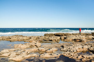 Landscape photographer work on sea coast. Mediterranean Sea, Cyprus