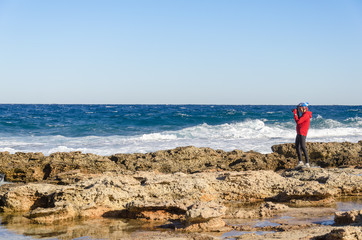 Landscape photographer work on sea coast. Mediterranean Sea, Cyprus
