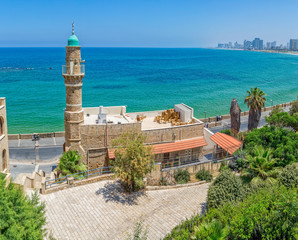 Morning panorama with the Al-Bahr Mosque in Jaffa with view of the beach, Tel Aviv riviera and hotels in distant, Israel.