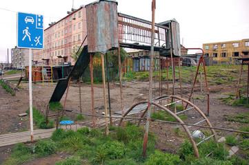 Old rusty damaged playground at Chersky town district Kolyma reg