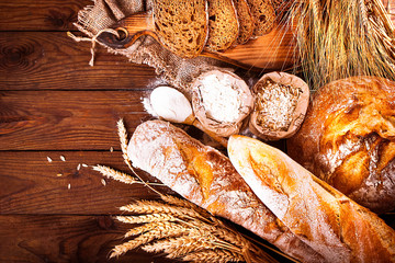 Homemade bread on wooden background. Country style. Food baking background
