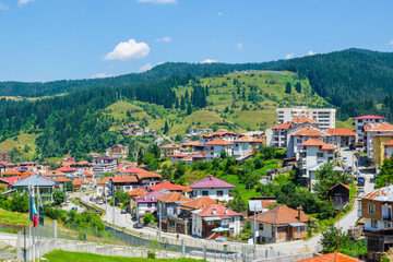 aerial view of bulgarian city chepelare which is famous ski resort and place of traditional rozhen folklore dances festival.