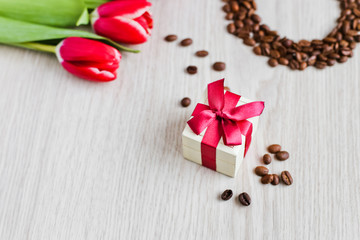 Red tulips, gift box coffee and corn