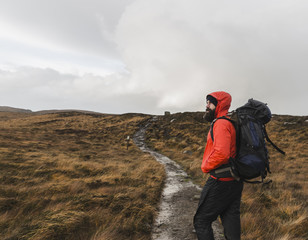 Man with backpack on footpath, Isle of Skye, Scotland