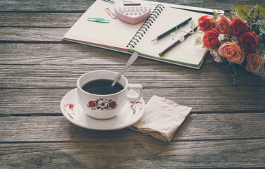Vintage Film Look: cup of coffee with notebook